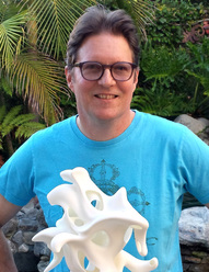 Kevin Mack with 3D printed sculpture, Mobius Ganesha
